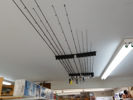 view of fishing rods on ceiling